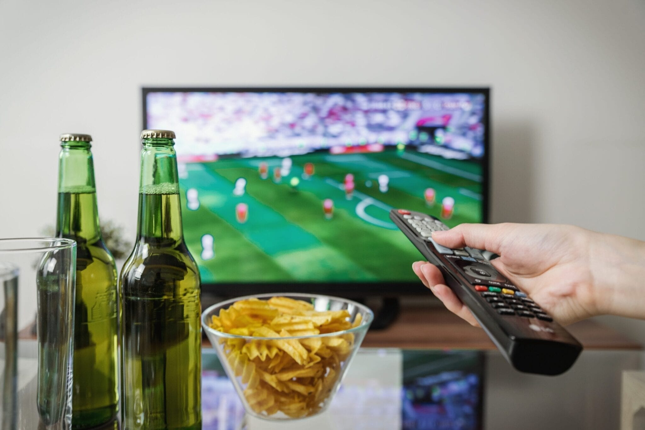 hand with remote and tv